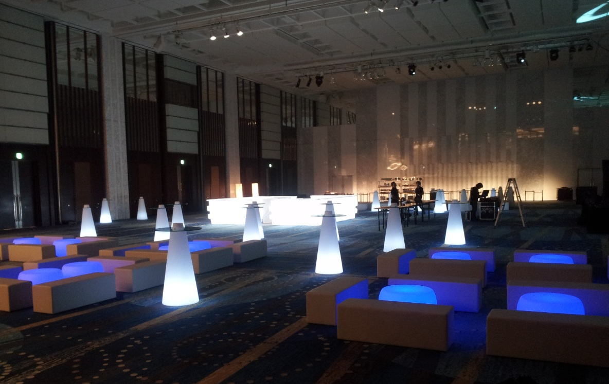 Combination of Round illuminated table and White Rectangular poufs